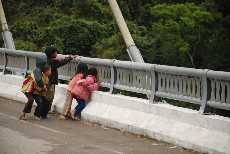 children looking over bridge