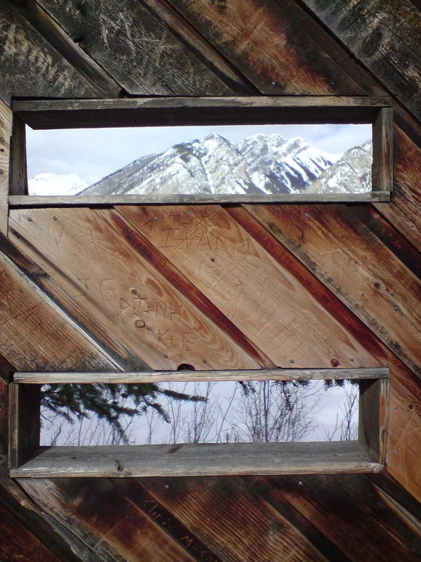 View through a bird box of mountains