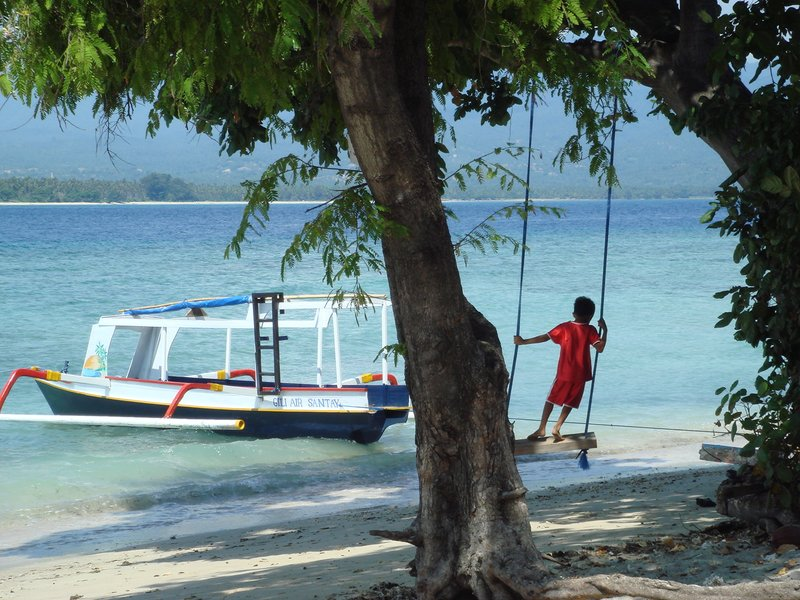 Swinging on the beach, Gili Air
