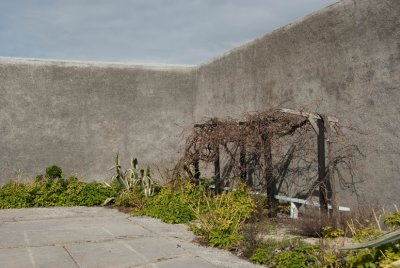 Mandela's prison garden where he hid a manuscript of his auto-biography. It was discovered a few weeks later when guards built the wall. Luckily, Mandela gave another copy to a prisoner who smuggled it out in his shoes and released it to the public sharing much information about the poor treatment of blacks.