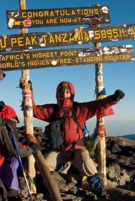 I made it! I'm at the summit with Juan beside me kissing the sign post in relief.