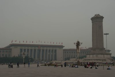 Tiananmen Square is surrounded by government buildings and full of tourist groups.
