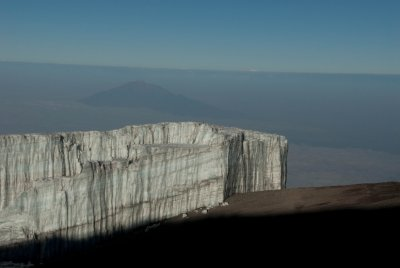 Kilimanjaro's disappearing glacier with Mount Meru in the background.