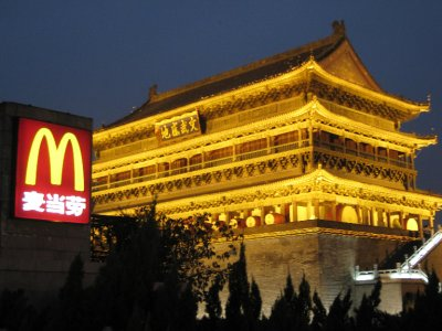 Xi'an's ancient bell tower and drum tower light up nicely at night, especially against the uber new neon mall signs and McD's. Ah, the signs of progress.