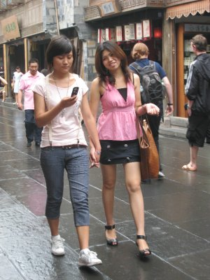 It is common to see women holding hands in China. It is a sign of comfort.