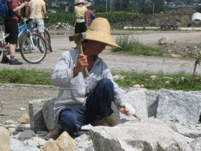 Marble workers on the side of the road.
