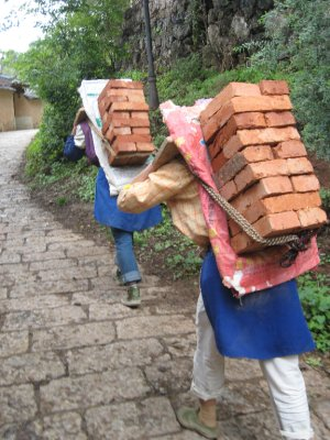 Women often carry the heavy loads.