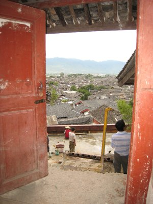 Lijiang is situated in a valley with many stores and homes built along the surrounding hills. The architecture and rooftops are amazing.