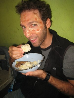 Dave eats a traditional meal of maize, a thick corn meal ball that resembles Elmers.
