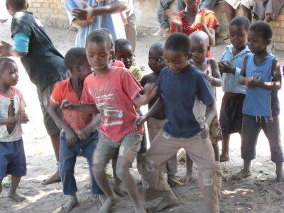 Malawi children embrace their local dance.