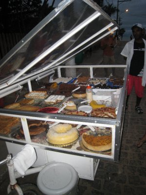 At night men set up mobile carts with a selection of cakes and sweets. I think the local church goers make the sweets and profits help the community.