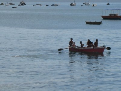 Groups of kids row from other neighborhoods along the bay to join the party.
