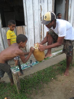 Itacare, Leo and kid opening jack fruit
