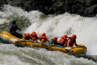 """Notice the faceless orange helmet two from the back. Underneath is Elizabeth. She stayed in this position and missed most of the rapids. Apparently she mistook the """"get down"""" command from the guide to mean there are snipers on the shoreline that you need to hide from."""