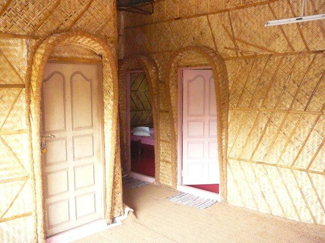 palm-leaf thatch walls at KTC tourist home