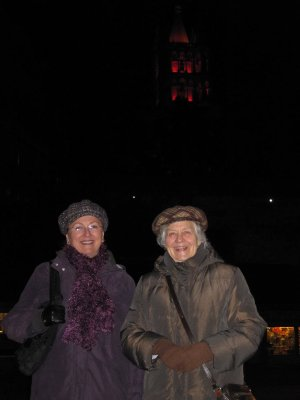 Jocelyne and Sandi with the Cathedral lit up in red, which you can just see in the background