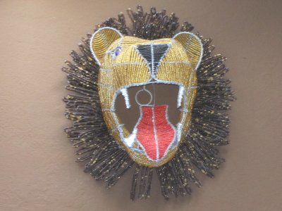 A beaded lion head trophy on the wall