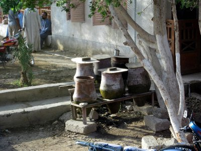 Water vessels in front of houses with free cool water for anyone passing by.