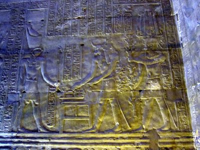 Horus, ram-headed god Khnoum (creator of humans) and god Amun, whose crown has 2 feathers.
