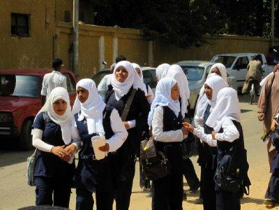 A group of uniformed schoolgirls on lunch break.