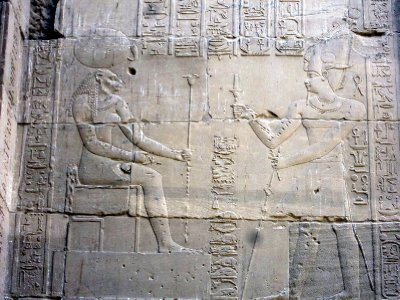 The Sun god Ra with a king on the right.