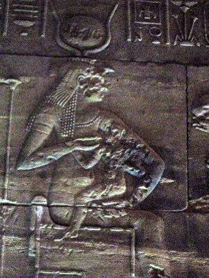 Isis suckling her son Osiris.