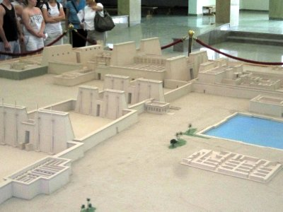 A model of the central Temple of Amun, which is the only part open to the public, and showing the sacred lake to the right.  This great temple at the heart of Karnak is so big that St Peter's, Milan and Notre Dame Cathedrals could be lost within its walls.
