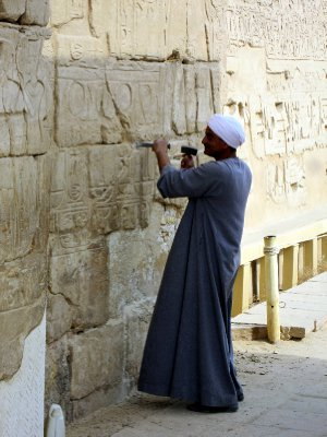 Aother one chiselling away at the wall; hope he knows what he is doing!