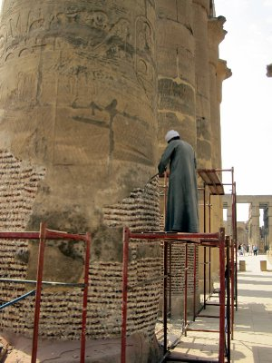 Workers restoring the columns in the Colonnade built by Amenhotep lll.
