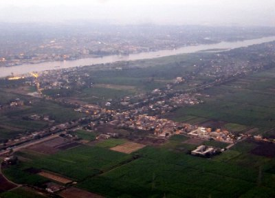 Green, fertile lands on the Westbank, with Luxor on the other side of the river.