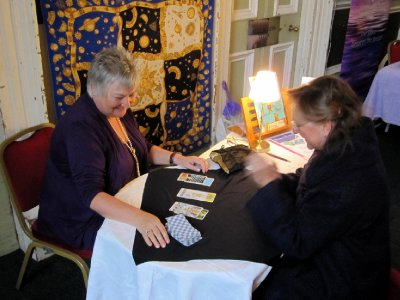 Bernie aka Mystic Meg reading Tarot cards at the local Holistic Fair.