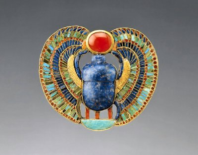 Tutankh-amun's scarab pectoral, encrusted with precious stones, and worn on the chest.
