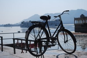 Bicycle with Lake Palace in background