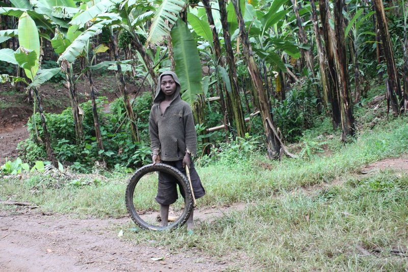 Kid with tire toy