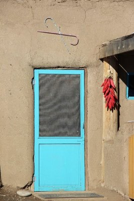 door in pueblo with candycanes