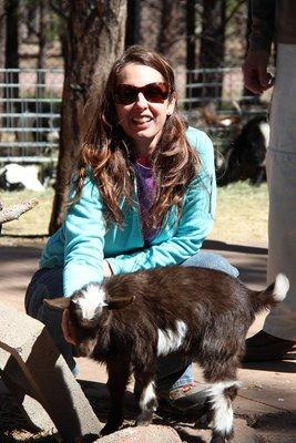 Christina petting a baby goat