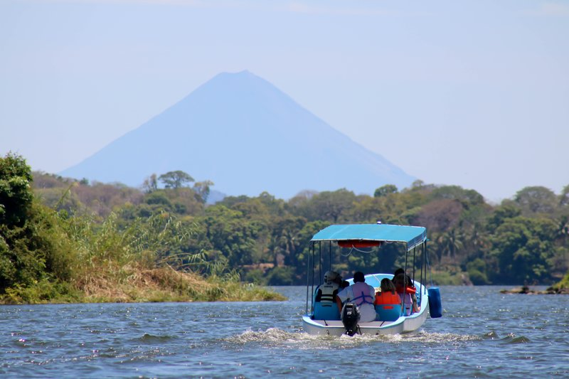 large_boat_ride_under_volcano.jpg