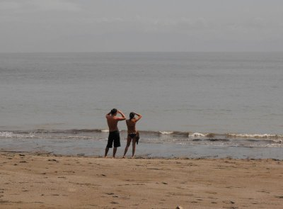 MONTEZUMA couple leaning on beach