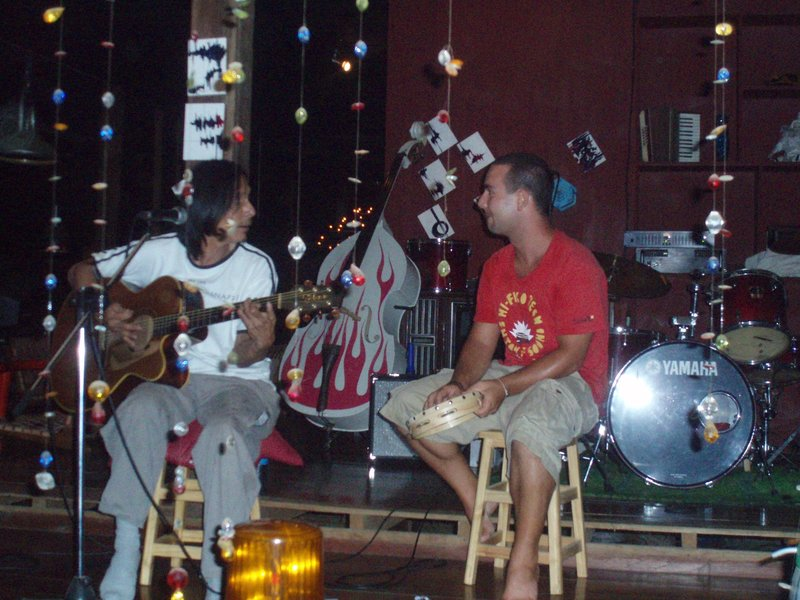 Jeremie jamming with a local at a pub