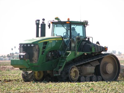 TRACTOR USED FOR PLOWING VEGETABLE FIELDS