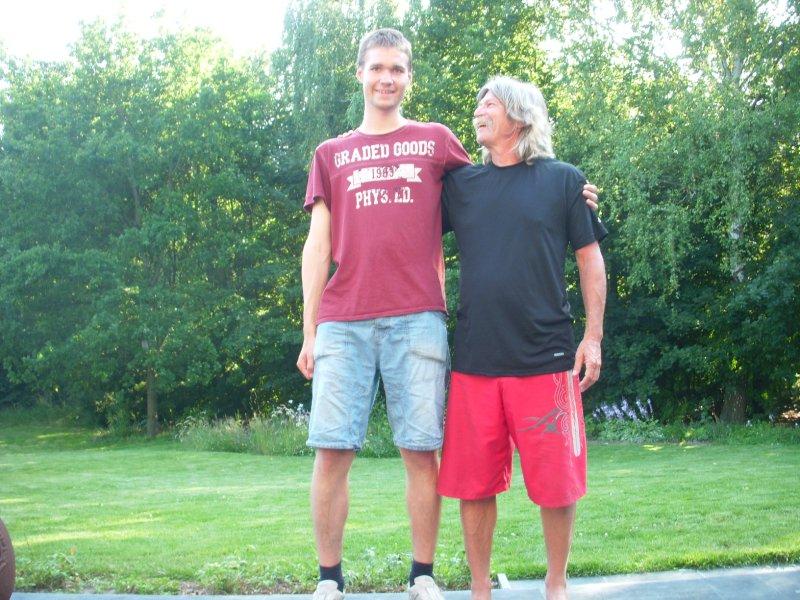Tom at 6 feet enjoys being dwarfed by Geert.