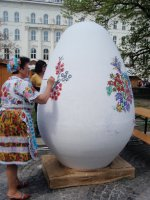 woman handpainting a giant egg!