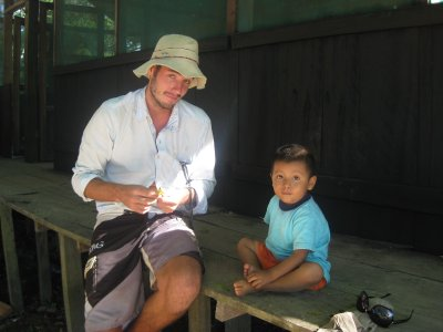 Josh with cute little boy at the river 'lodge'