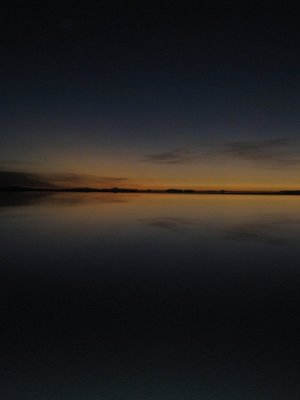 Reflection before sunrise on the wet salt flat