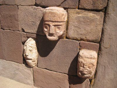 Heads of priests carved into the wall of the temple