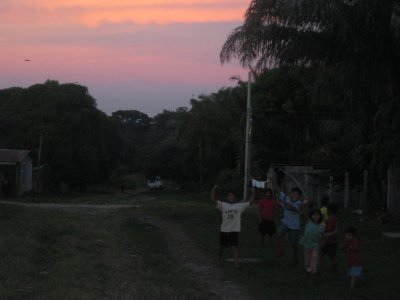 Sunset in Tumupasa and children playing