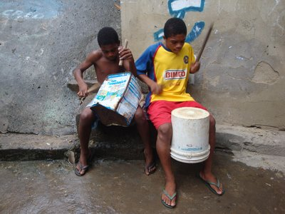 Favela Boys Playing on Recycled Material
