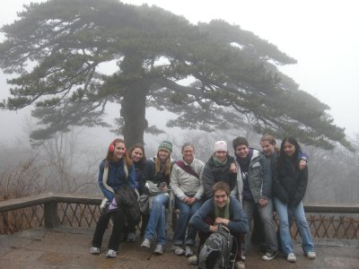 Group in front of a pine tree