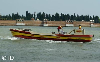 DHL boat - transports the post mail - Venice