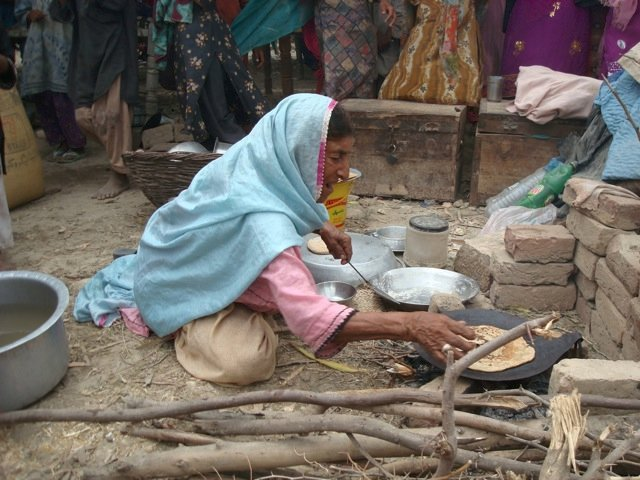 Cooking chapatis in camp